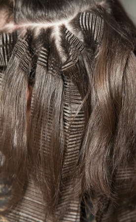 crimp: Closeup of crimp and straight hair locks with selective focus Stock Photo