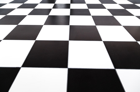 chequer: Checkered styled tile floor with selective focus