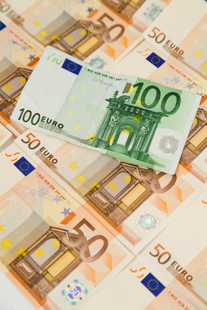 one hundred euro banknote: Vertical closeup of one hundred euro banknote on money background