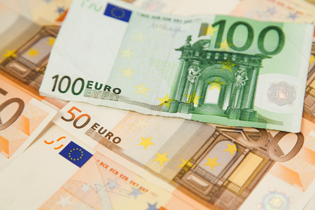 one hundred euro banknote: Closeup of one hundred euro banknote on money background Stock Photo