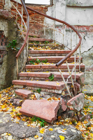 demolished: Abandoned grungy stairs outdoors with railings