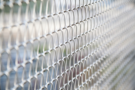 mesh fence: wire mesh fence with selective focus Stock Photo