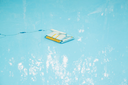 automatic: Underwater automatic vacuum cleaner in pool Stock Photo