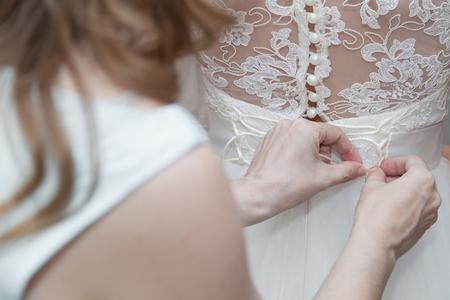bridesmaid: Bridesmaid lacing corset of wedding gown