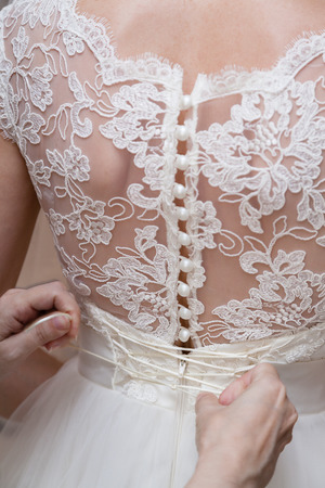 lacing corset of wedding gown Stock Photo