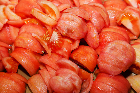 peeled and sliced fresh tomatoes with selective focus Stock Photo