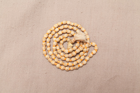 rolled chanting beads on woolen texture