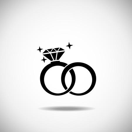 ring engagement: Los anillos de boda icono sobre un fondo blanco Vectores