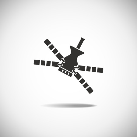 to revolve: Satellite Space Station flying over Earth. Isolation icon
