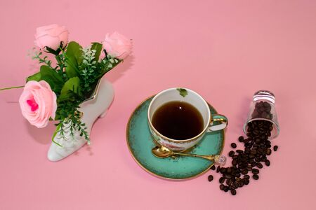 coffee, flowers, candles on a pink background as a symbol of home warmth and coziness, beauty and a wonderful morning breakfast Stock fotó
