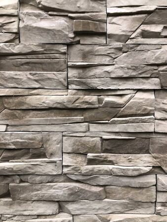 background, texture of the old ragged stone gray-brown color. Used for walls