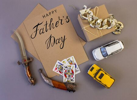 holiday greeting card for father's day with text on a gray background, brutal