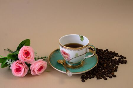 coffee, flowers, candles on a beige background as a symbol of home warmth and coziness