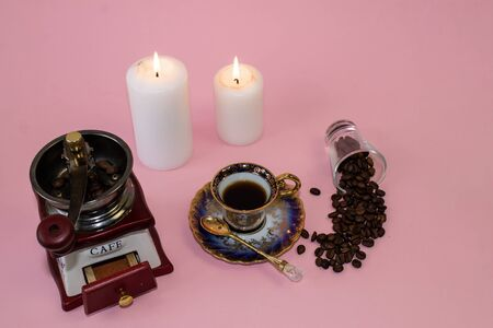 coffee, flowers, candles on a pink background as a symbol of home warmth and coziness, beauty and a wonderful morning breakfast