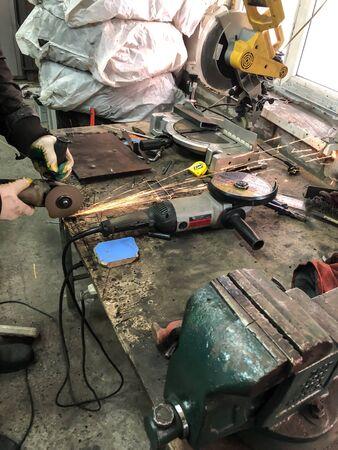 man auto mechanic working in a garage, workshop