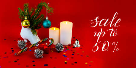 Internet banner, card, flyer about New Year, Christmas discounts, text - sale up to 50, on a red background