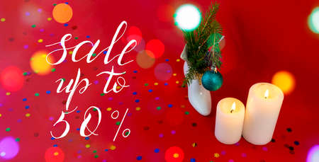 Internet banner, card, flyer about New Year, Christmas discounts, text - sale up to 50, on a red background. bokeh effect