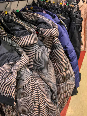 Women's clothing on a hanger in the store - coats, jackets, blouses