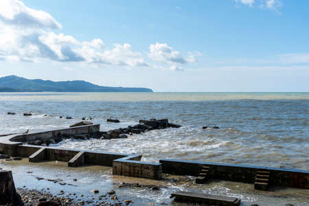 the black sea after the storm, brown water and debris on the shore Stock fotó