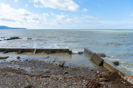 the black sea after the storm, brown water and debris on the shore
