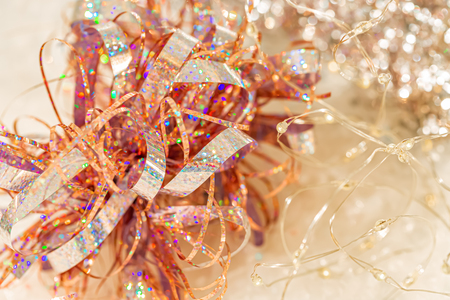 Abstract Christmas glow backdrop. Background of blur colorful texture bokeh and garland for Festival and New year. Game of color. Soft focus
