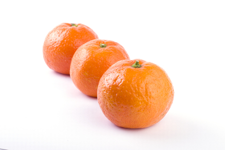 fresh mandarines isolated on white background. Oranges are arranged in rows. Placed on a white background.