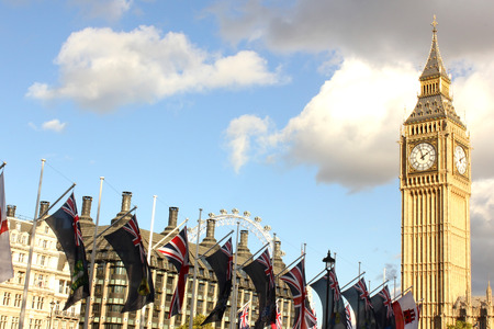 parliament square: Big Ben, London Eye and British flags from Parliament Square by day, London