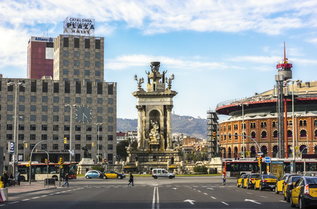 Barcelona, Spain - March 10, 2014   Plaza de Espana with the Les Arenes bullring and fountain by sunny spring day