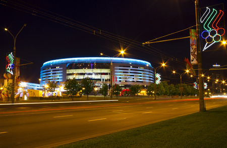 Minsk, Belarus - May 9, 2014  Night view of illuminated Minsk Arena building during the Ice Hockey World Championship 2014  Minsk Arena is one of the main venues for IIHF