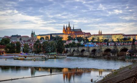 vltava: Prague Castle, Charles Bridge and the embankment of Vltava River by summer evening, Prague