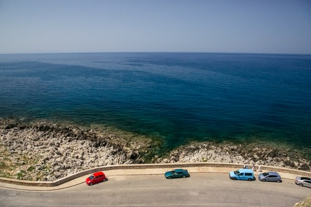 Road cut off the sea and mountains. The blue sea along the way.Photos from the top to the bottom.High angle view 版權商用圖片