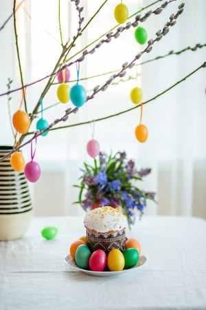Easter cake with painted eggs on the table. Preparation for the holiday.