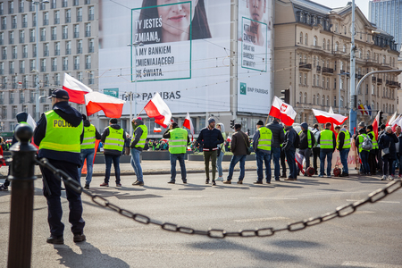 Warsaw Poland. April 3, 2018. Rally of protesters in Warsaw. Protesters holding posters and flags of Poland. On the perimeter are the police.