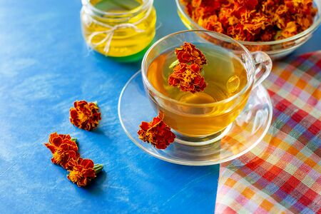 A cup of tea from the flowers of Calendula and Chernobrivtsov. Processing of dried flowers marigolds.