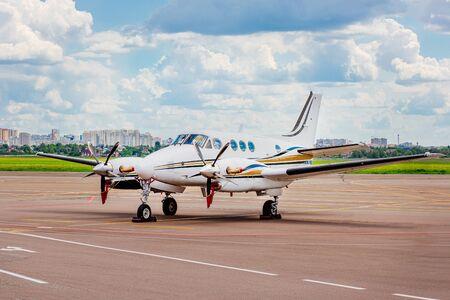 Private jet on the runway. Jet airplane stop for wait VIP passenger on runway. Comfortable flights. Reklamní fotografie