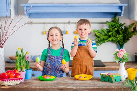 Happy easter. Cute brother and sister, funny kids boy and girl are preparing for the holiday.