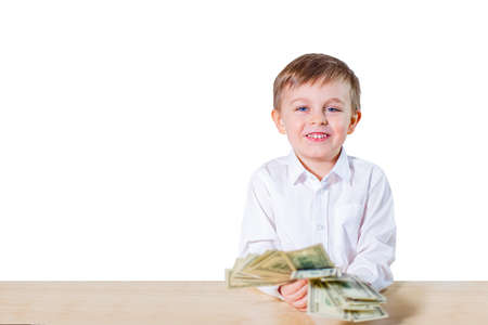 Young businessman holds money in his hands, american hundred dollars cash. American one hundred dollars in cash. 免版税图像