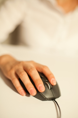female hand on mouse photo