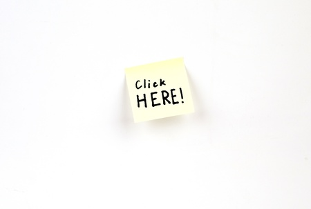 Click Here! on a post-it note Stock Photo