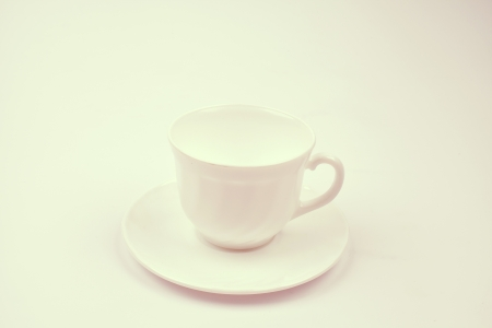 cup with saucer on white