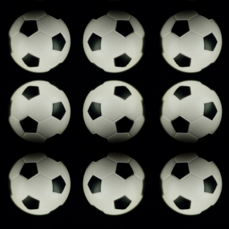 soccer balls isolated on black background