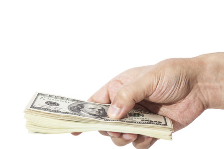 mans hand holding  handful of dollars isolated on white photo