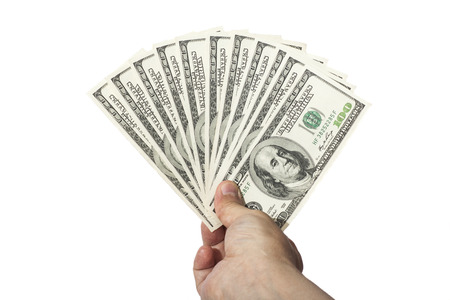 hand holding 100 dollar banknotes money isolated on white background  photo