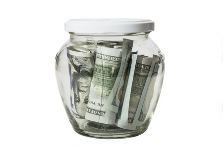 thrift box: Money banknotes jar full of savings isolated on white background