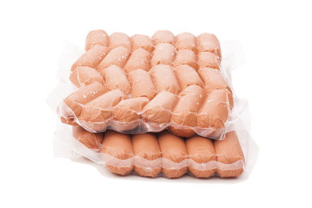 half stuff: Packs of sausages isolated on white  Stock Photo