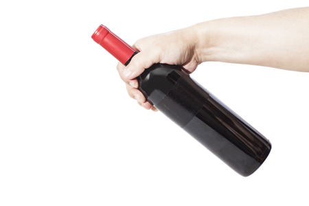 Hand holding red wine bottle  isolated on white  Stock Photo