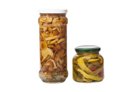Glass jar of preserved mushrooms and canned peppers Reklamní fotografie