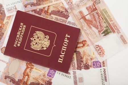 Russian passport on the money background