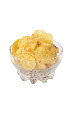 Delicious potato chips in bowl isolated on white Stock Photo