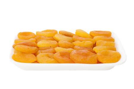 Dried apricots in  shopping package, isolated  Stock Photo